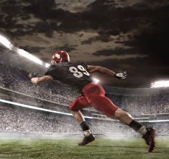 Фотографии Мужчины Американский футбол Ноги Шлем Униформа Спорт