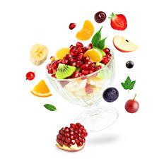 Картинка Фрукты Ягоды Гранат Белый фон Продукты питания