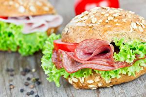 Фото Фастфуд Бутерброды Булочки Колбаса Сэндвич