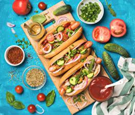 Картинки Фастфуд Хот-дог Булочки Овощи Огурцы Помидоры Кетчупа Продукты питания
