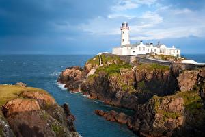 Обои Ирландия Маяки Море Утес Fanad Head Lighthouse Природа