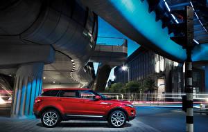 Фото Range Rover Красный Металлик Сбоку 2011 Range Rover Evoque Prestige Автомобили