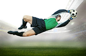 Обои Футбол Мужчины Вратарь в футболе Мяч Прыжок Ноги Спорт