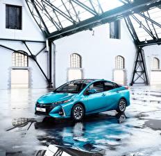 Картинки Toyota Голубая Металлик Гибридный автомобиль 2016 Prius Plug-in Hybrid