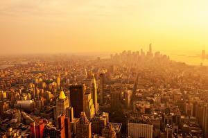 Картинки Небоскребы Дома Рассвет и закат Штаты Нью-Йорк Манхэттен Мегаполис город