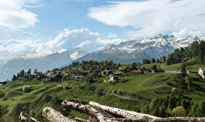Фото Швейцария Здания Горы Альпы Облака Veulden Города