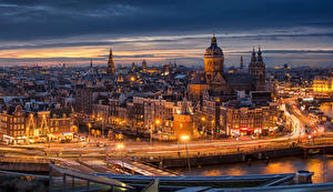 Обои Амстердам Нидерланды Здания Дороги Ночь Уличные фонари
