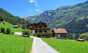 Фотографии Швейцария Здания Горы Дороги Трава Weissenberge Города