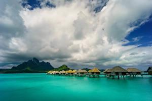 Фотография Французская Полинезия Тропики Море Небо Горы Бора-Бора Облака Бунгало
