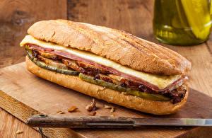 Фотография Фастфуд Бутерброды Булочки Ножик Сэндвич Разделочная доска