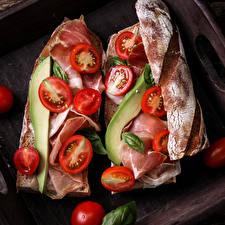 Фотографии Фастфуд Бутерброды Булочки Помидоры Ветчина Двое Еда