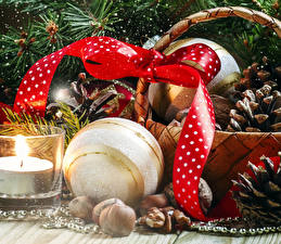 Обои Праздники Новый год Свечи Шарики Бантик Корзинка Шишки Лента фото