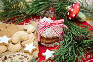 Фотографии Рождество Печенье Звезды Ветки Бантик Продукты питания