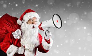 Обои Праздники Новый год Санта-Клаус Шапки Снежинка Громкоговоритель