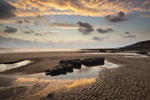 Обои Великобритания Побережье Небо Камни Песок Облака Dunraven Bay Wales Природа фото