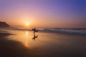 Фотографии Рассветы и закаты Берег Волны Серфинг Вечер Солнце Пляж Природа