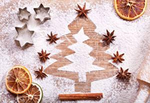 Картинка Новый год Корица Апельсин Сахарная пудра Бадьян звезда аниса Новогодняя ёлка