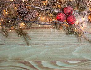 Обои Праздники Новый год Ветки Шарики Шишки Снег Гирлянда Шаблон поздравительной открытки Доски