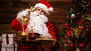 Обои Новый год Мужчины Шапки Дед Мороз Телефон Борода фото