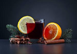 Картинки Новый год Напиток Цитрусовые Корица Орехи Апельсин Лимоны Стакан Ветвь Пища