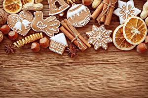 Фотографии Рождество Печенье Корица Орехи Лимоны Бадьян звезда аниса Дизайн Доски Шаблон поздравительной открытки Еда