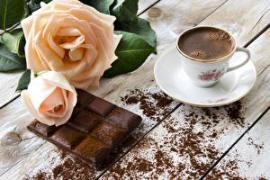 Фото Розы Кофе Шоколад Чашке Доски Блюдце Какао порошок Пища Цветы