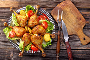 Фотография Курица запеченная Мясные продукты Овощи Ножик Доски Разделочной доске Еда