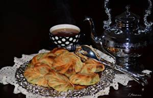 Фотография Выпечка Чай Чайник Черный фон Чашка Пища