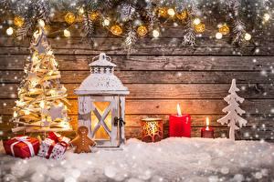 Картинки Рождество Праздники Свечи Елка Снежинка Подарок Доски Снега Фонари