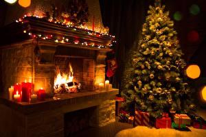 Обои Новый год Огонь Праздники Свечи Камин Елка Подарки фото