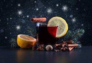 Фотография Напитки Лимоны Корица Бадьян звезда аниса Стакан Ветки Продукты питания