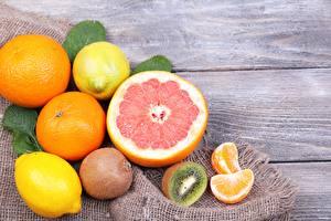 Картинка Цитрусовые Грейпфрут Киви Лимоны Мандарины Доски Пища