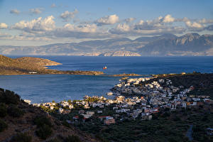 Картинки Греция Дома Море Горы Облачно Elounda Beach Города