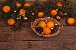 Фотография Новый год Мандарины Доски Ветвь Шишки Шарики Пища