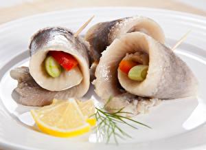 Фотография Морепродукты Рыба Лимоны Продукты питания
