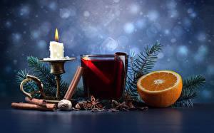 Фотографии Рождество Свечи Напиток Корица Апельсин Орехи Ветвь Стакана Еда