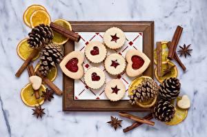 Картинки Печенье Лимоны Корица Бадьян звезда аниса Сердце Шишки