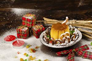 Картинки Рождество Печенье Свечи Сладости Желе Сахарная пудра Подарки Бантик