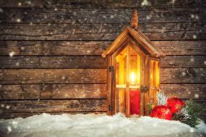 Фотографии Рождество Праздники Свечи Доски Снега Шар