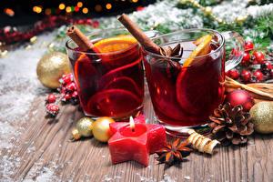 Фотография Новый год Праздники Напитки Свечи Лимоны Корица Бадьян звезда аниса Стакан Шар