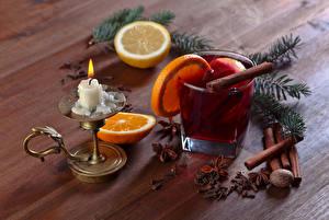 Обои Новый год Напиток Свечи Лимоны Корица Апельсин Доски На ветке Продукты питания