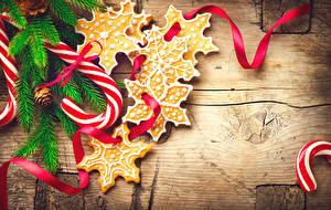 Картинки Новый год Сладости Печенье Леденцы Доски Ветки Снежинки Candy cane