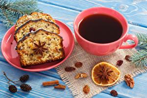 Картинка Новый год Выпечка Кофе Праздники Кекс Доски Тарелка Чашка