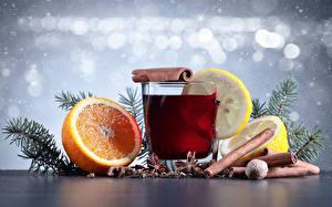 Фотографии Рождество Напитки Корица Цитрусовые Лимоны Апельсин Стакан На ветке Пища
