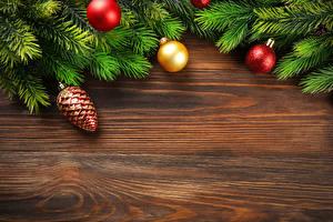 Обои Новый год Доски Ветки Шарики Шишки Шаблон поздравительной открытки фото