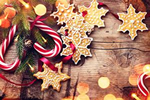 Фотографии Рождество Печенье Сладости Доски Снежинки