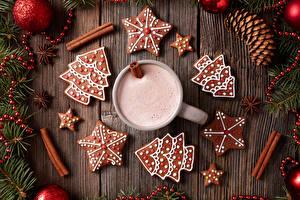 Фото Новый год Печенье Напитки Корица Доски Дизайн Ветки Елка Чашка Еда