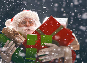 Картинка Новый год Санта-Клаус Подарки Снежинки