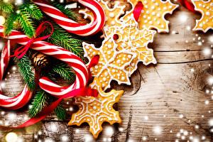 Фотография Новый год Печенье Сладости Леденцы Дизайн Ветки Снежинки Candy cane Еда