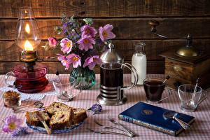 Фотографии Натюрморт Кекс Напитки Кофе Космея Молоко Керосиновая лампа Доски Чашка Книга Вилка столовая Бутылка